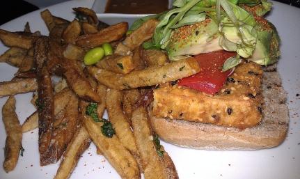 open face sesame crusted tofu sandwich | avocado | lemon soy aioli | tomato | edamame| whole grain bread | truffle fries photo courtesy of The Harrises of Chicago